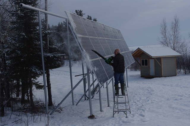 ron_blowing_snow_off_solar_panels_139